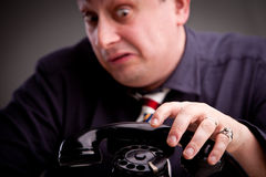 Clerk scared of phone call Stock Photos