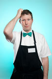 Clerk scratching his head Royalty Free Stock Photos