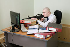 Clerk shoots from a rifle at the monitor Stock Photo
