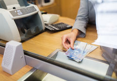 Clerk with swiss francs cash money at bank office Stock Photography
