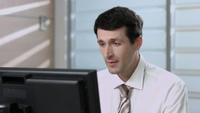 Clerk working at the computer. stock footage
