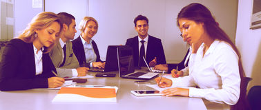 Clerks in conference room Royalty Free Stock Images