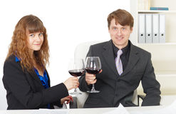 Clerks drink wine in office - celebrate Stock Photos