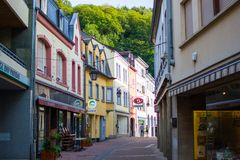 Clervaux, Luxembourg; 08/11/2018: Narrow street in middle of Clervaux, in Luxembourg, with typical houses at both sides.  royalty free stock images