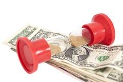 Clessidra con i dollari Immagini Stock Libere da Diritti