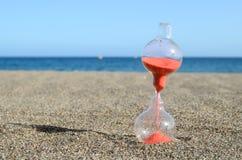 Clessidra su una spiaggia Immagine Stock Libera da Diritti