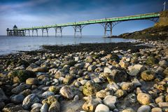 Clevedon pier and beach in sunlight on Somerset coast. The only remaining Grade 1 listed pier was made using Victorian railway iron in the nineteenth century Stock Photos