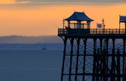 Clevedon Pier Silhouette. Historic Victorian Clevedon Pier in North Somerset, England, silhouetted against the sunset Stock Photos