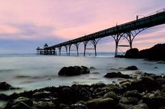 Clevedon pier somerset england uk. Sunset at Clevedon pier somerset england uk royalty free stock photo