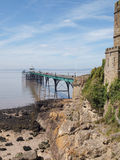 Clevedon Pier & Toll House, Somerset, England. Clevedon Pier and it's toll house wall leading onto the beach in North Somerset, England on a blue sky summer day royalty free stock image