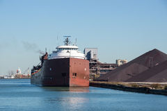 Cleveland Bulk Terminal. A Great Lakes self discharging bulk carrier laden with iron ore taconite prepares to offload her cargo at the Cleveland Bulk Terminal in royalty free stock photo