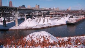 A bridge underlying the Cleveland Skyline - The Snowy Cuyahoga - CLEVELAND - OHIO - USA. Cleveland is a major city in Ohio on the shores of Lake Erie. Landmarks stock photo
