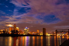 Cleveland moonrise. Moonrise over downtown Cleveland, Ohio, seen from the mouth of the Cuyahoga River royalty free stock images