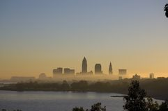 Cleveland Morning Fog. Early morning fog covers downtown Cleveland as seen from Edgewater park just west of city. A small bay on lake Erie is in the foreground Stock Images