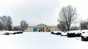 The Cleveland Museum of Art south entrance looks out over a fresh snowfall in Wade Park. The Cleveland Museum of Art stately south entrance looks out on a snow stock photo