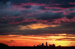 Cleveland Ohio skyline at sunset photograph. Clouds loom over downtown Cleveland city skyline from Chapin Forest in the fall royalty free stock images