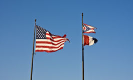 Cleveland, Ohio and USA flags. Against blue sky stock photography