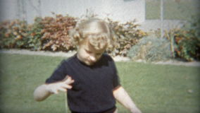 CLEVELAND, OHIO 1953: Young girl playing outdoors with Yo Yo toy. Original vintage 8mm film home movie professionally cleaned and captured in 4k (3840x2160 UHD stock video