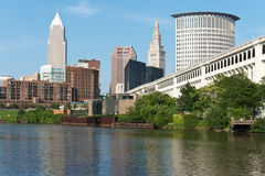 Cleveland Riverview. Several of the skyscrapers, apartment complexes, and a major bridge as seen from the bank of the Cuyahoga River in Cleveland, Ohio stock photography