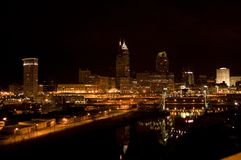 Cleveland Skyline 09. Cleveland skyline at night reflecting in Cuyahoga river Stock Photo