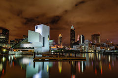 Cleveland Skyline at Night. The Cleveland, Ohio skyline on an overcast night with the Rock and Roll Hall of Fame and reflections in the water stock image