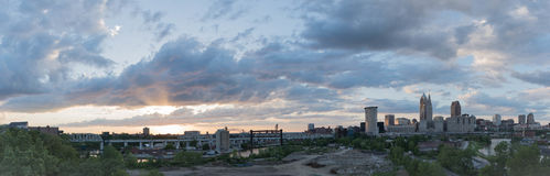 Cleveland Skyline. Panoramic shot of the Cleveland city skyline, green spaces, and industrial/shipping areas at sunset royalty free stock photo