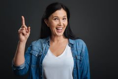 Clever ambitious woman stating her opinion excitedly. I can prove that. Intelligent polite expressive lady holding her finger up while having a debate with Royalty Free Stock Photography