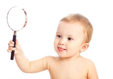 Clever baby. With a magnifier glass Stock Image
