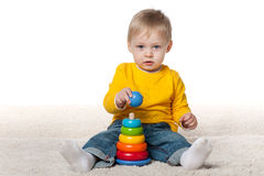 Clever baby boy with a toy Stock Images