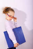 Clever blond girl with folder Stock Photo