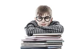 Clever boy. Educational theme: funny teenager with books. Isolated over white background royalty free stock photos