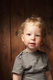 Clever boy. On wood background stock image