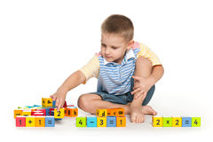 Clever boy with blocks on the floor Royalty Free Stock Photography