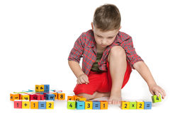 Clever boy with blocks on the floor Royalty Free Stock Photos
