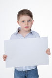 Clever boy holding blank panel Royalty Free Stock Image