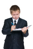 Clever boy with a notebook Stock Image