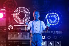 Clever boy using the diagrams while studying in a coding school Stock Images