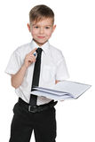 Clever boy in white shirt with a notebook Royalty Free Stock Images