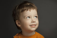 Clever boy. On wood background stock photo