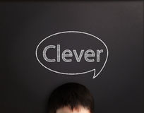 Clever boy. A word of clever on board Royalty Free Stock Image