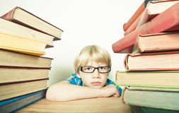 Clever child with books stock photos