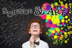 Clever child boy looking at maths formula and art pattern background. Brainstorming, creativity and education concept.  royalty free stock photo