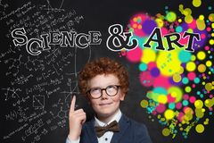 Clever child pointing finger at science and arts inscription royalty free stock photo