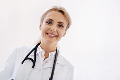Clever competent woman helping people staying healthy Stock Photos