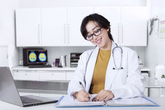 Clever doctor working in hospital Stock Photography