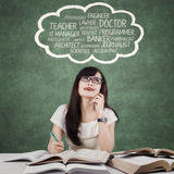 Clever female learner imagine her dreams Royalty Free Stock Images