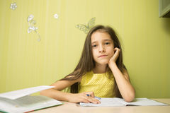 Clever girl doing homework Royalty Free Stock Photo