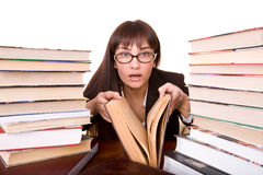 Clever girl with heap book. royalty free stock images