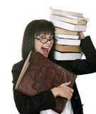 Clever girl with heap book. Royalty Free Stock Image