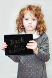 Clever girl holding a blackboard Royalty Free Stock Photos